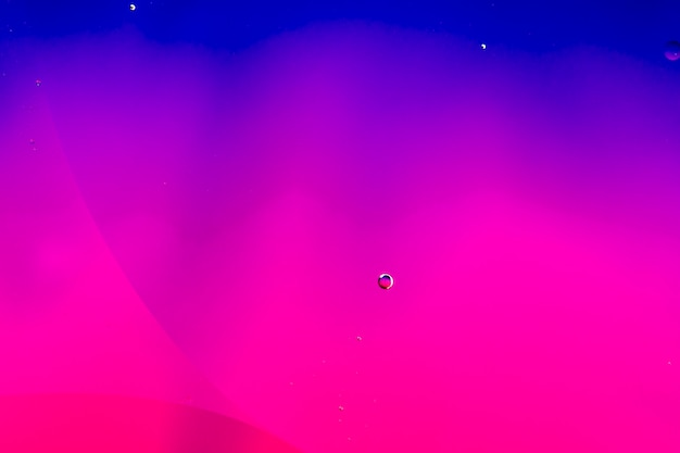 Abstracte kleurrijke achtergrond in olie en golven op waterspiegel Gratis Foto