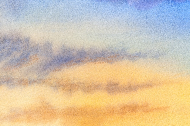 Abstracte kunst lichtblauwe en gele kleuren als achtergrond. aquarel schilderij op canvas met vlekken. Premium Foto