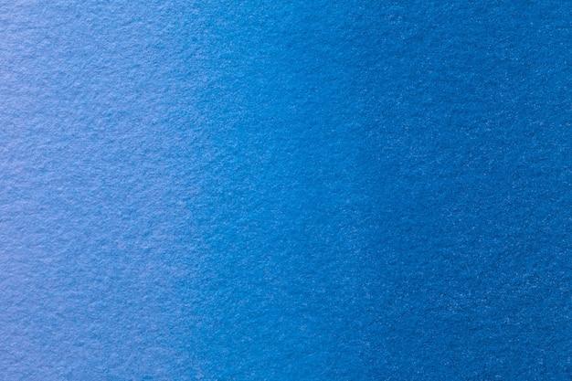 Abstracte kunst marineblauwe kleuren als achtergrond. aquarel op canvas met zacht denim verloop. Premium Foto