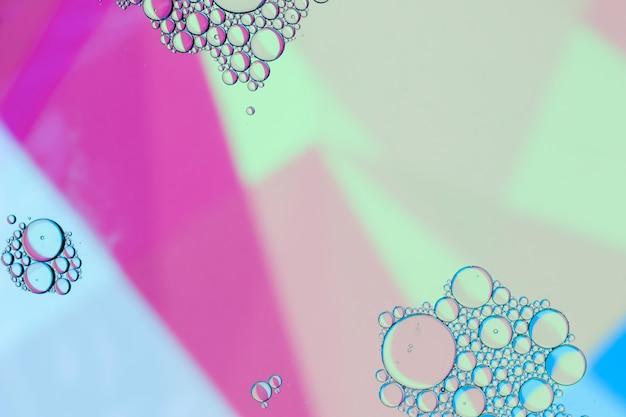 Abstracte olie roze tinten achtergrond Gratis Foto