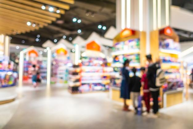 Abstracte onduidelijk beeld en defocus mooie luxe het winkelcomplex binnenlandse, vage fotoachtergrond Gratis Foto