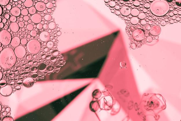 Abstracte piramide met bubbels in roze Gratis Foto