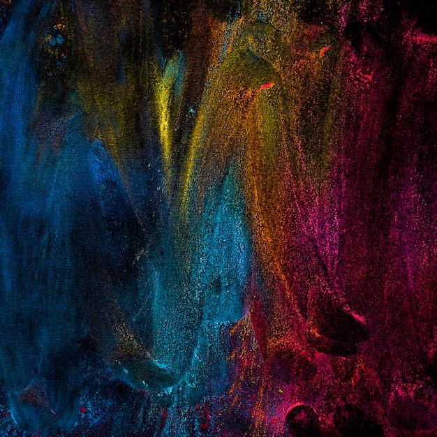 Abstracte poederkleuren spatten over zwarte achtergrond Gratis Foto