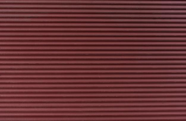 Abstracte rode metalen muur achtergrond Gratis Foto
