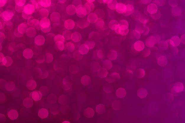 Abstracte roze achtergrond. prachtig bokeh-effect. lichte cirkels achtergrond. Premium Foto