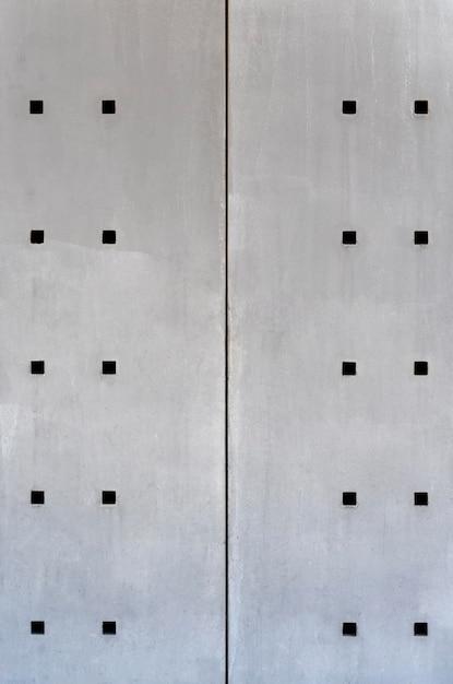 Abstracte stalen wand met vierkante gaten vooraanzicht Gratis Foto