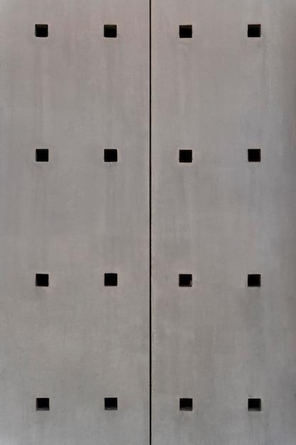 Abstracte stalen wand met vierkante gaten Gratis Foto