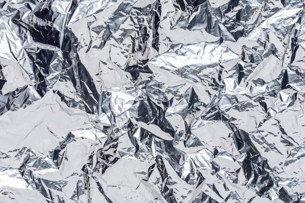 Abstracte zilveren verfrommelde folieachtergrond. Premium Foto