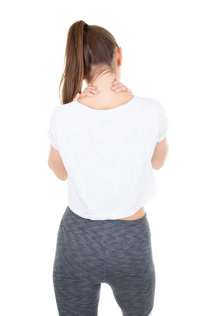Achteraanzicht jonge vrouw zelfacupressuur voor ontspannen schouder en rugpijn Premium Foto
