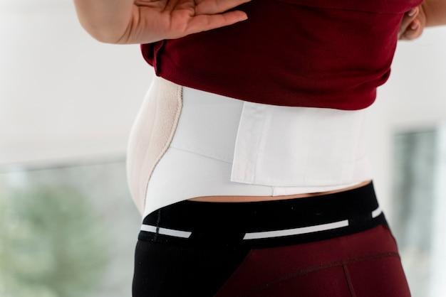 Achteraanzicht zwangere vrouw slijtage Gratis Foto