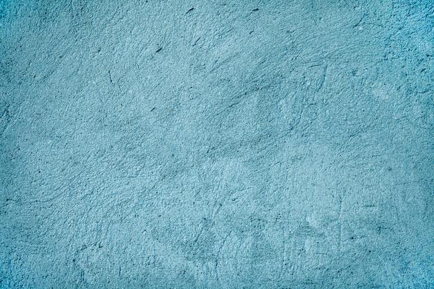 Achtergrond - blauwe de verfmuur van de korreltextuur. de muurtextuur van het cement in blauwe kleur. Premium Foto
