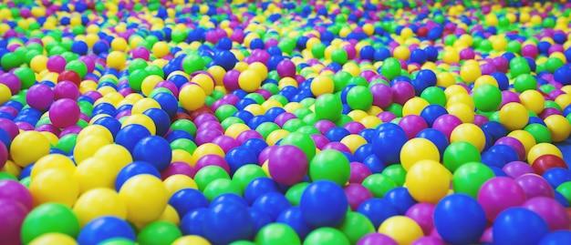 Achtergrond van heldere veelkleurige plastic ballen Premium Foto