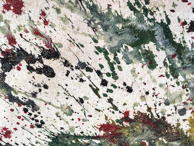 Achtergrond van kleurrijke spatten van witte en groene verf. fragment van kunstwerk Premium Foto