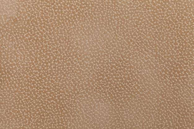 Achtergrond van lichtbruin stoffen flock, versierd met een vacht van het dier. pluisvrije doek. Premium Foto