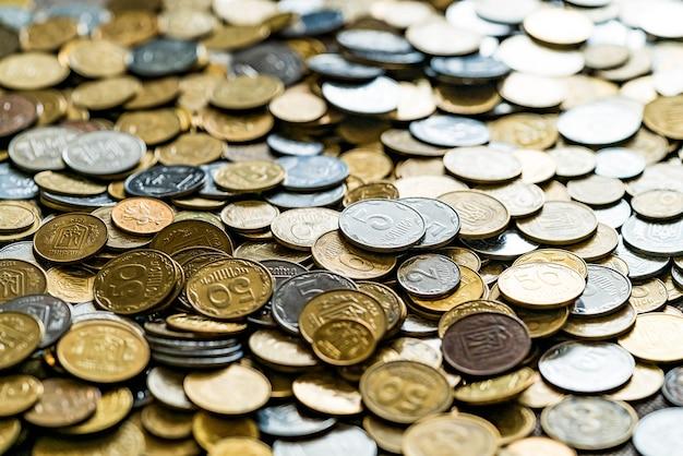 Achtergrond van munten. munten sluiten omhoog Premium Foto