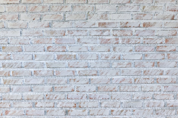 Achtergrond van oude uitstekende vuile bakstenen muur met schilpleister, textuur Premium Foto