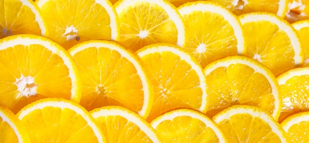 Achtergrond van stukjes sinaasappel Premium Foto