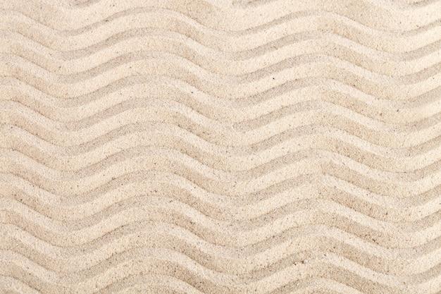 Achtergrond van zee zand. zomerrust. Premium Foto