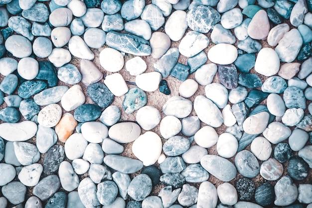 Achtergrondtextuur van kiezelstenen van kleuren de kleine stenen Premium Foto