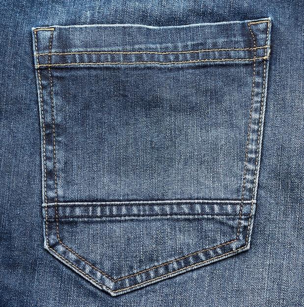 Achterzak van blauwe spijkerbroek, volledig frame, close-up Premium Foto