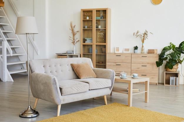 Afbeelding van de huiskamer met modern meubilair erin Premium Foto