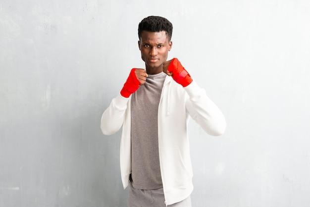 African american sportmanin boksbandages Premium Foto