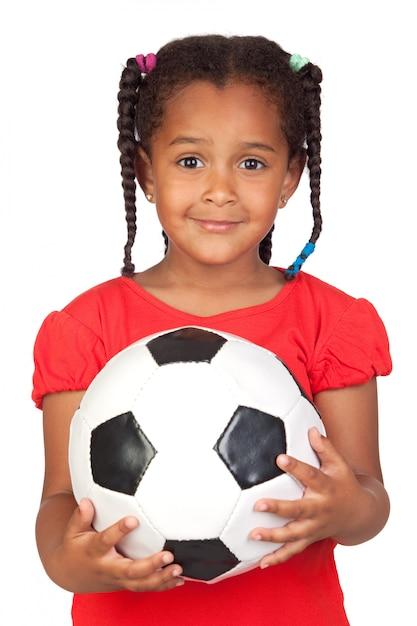 Afrikaans meisje met een voetbal Premium Foto