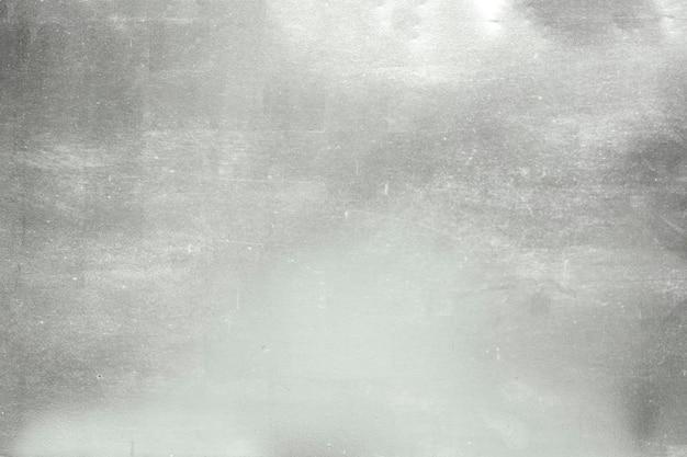 Aluminium achtergrond of textuur en gradiënten schaduw. zilveren achtergrond. Premium Foto
