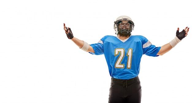 Amerikaanse voetballer vormt in uniform Premium Foto