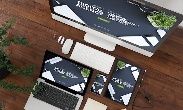 Apparaten bovenaanzicht collectie 3d-rendering met website van digitaal bureau op scherm Premium Foto
