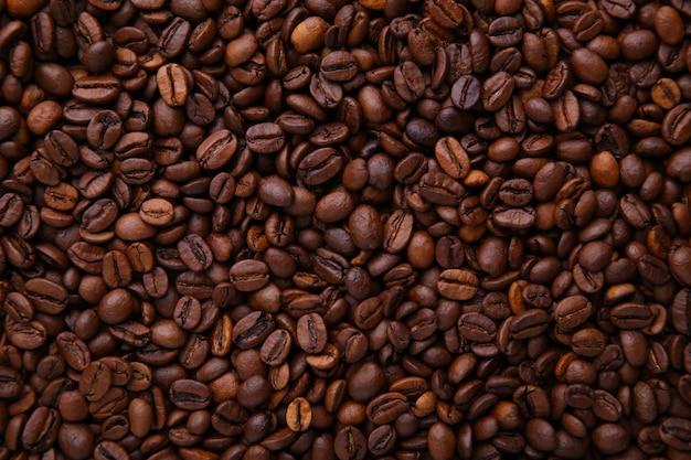 Aroma koffiebonen achtergrond. sluit koffie. Premium Foto