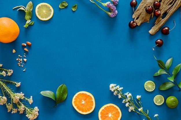 Assortiment van tropische citrusvruchtenachtergrond Gratis Foto