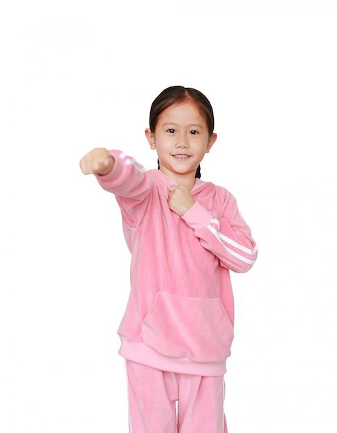Aziatische de gevechtsuitdrukking van het kindmeisje Premium Foto