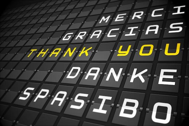 Bedankt in talen op zwart mechanisch bord Premium Foto