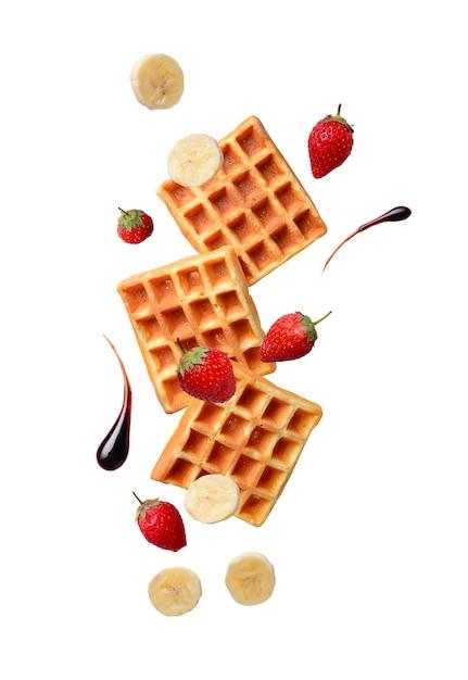 Belgische wafels met aardbeien en banaan Premium Foto