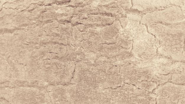 Beschadigde oppervlaktetextuur lichtbruine achtergrond Gratis Foto