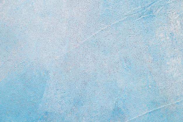 Betonnen muur beschilderd met blauwe kleur Gratis Foto