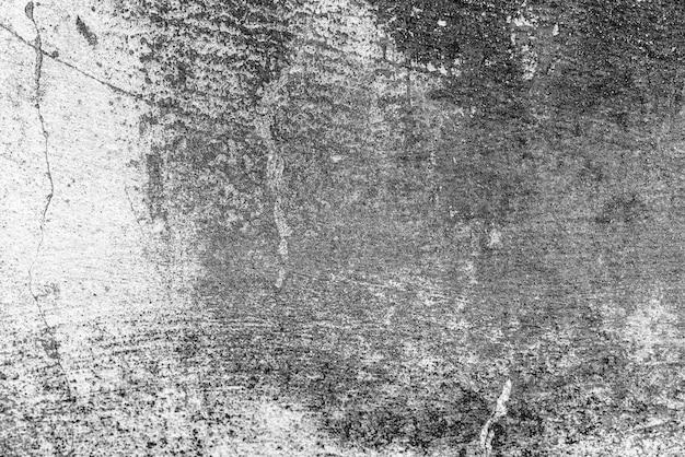 Betonnen muur met scheuren en krassen Premium Foto