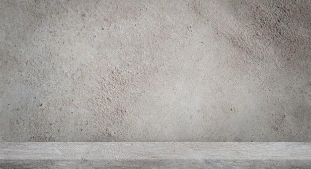 Betonnen vloer met lege grijze betonnen muur. Premium Foto