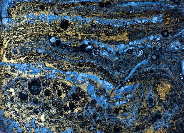 Blauw marmerpatroon. gouden marmeren vloeibare textuur. Premium Foto
