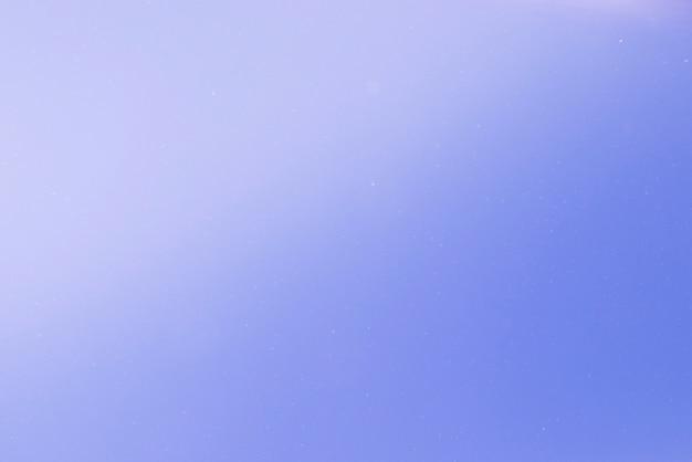 Blauwe abstracte achtergrond met lichte vlekken Gratis Foto