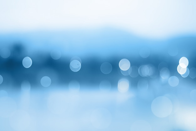 Blauwe achtergrond met kleurovergang of bokeh abstract ontwerp Premium Foto