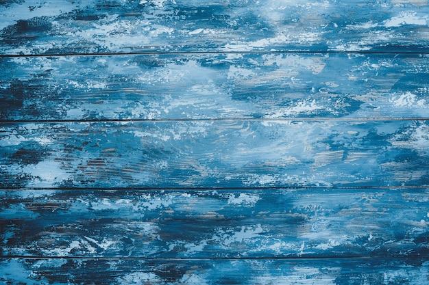 Blauwe achtergrond van geschilderde planken Premium Foto