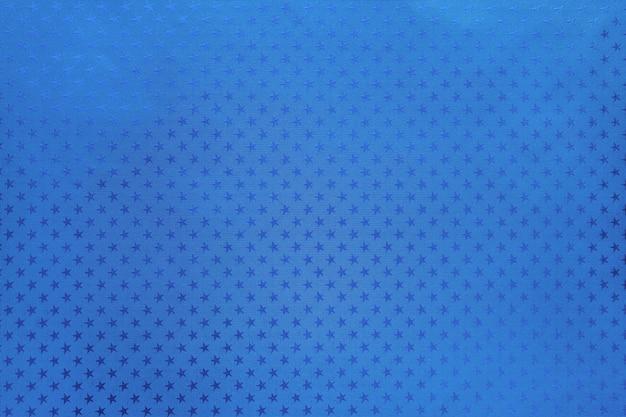 Blauwe achtergrond van metaalfoliedocument met een sterrenpatroon Premium Foto