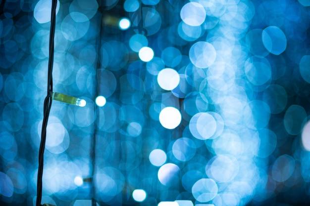 Blauwe bokeh vage lichtenachtergrond Premium Foto