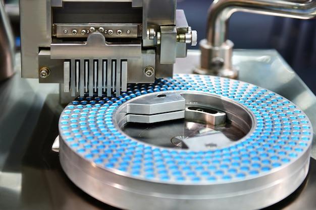 Blauwe capsule pil productielijn Premium Foto