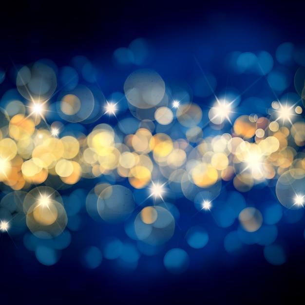 Blauwe en gouden kerstmisachtergrond met bokehlichten en sterren Gratis Foto
