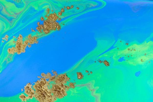 Blauwe en groene oceaan abstracte achtergrond. vloeibaar marmerpatroon met goudpoeder. Premium Foto