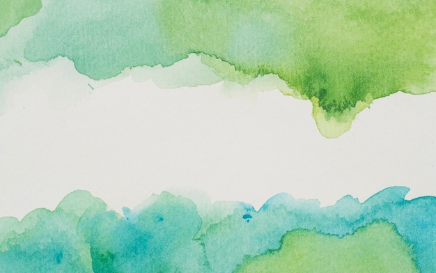 Blauwe en groene verf op wit papier Gratis Foto