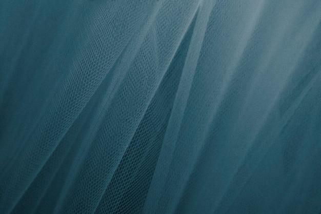 Blauwe getextureerde tule gordijnen Gratis Foto